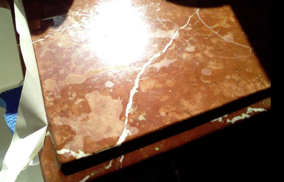 Etched corner on Countertop. Red Alicante