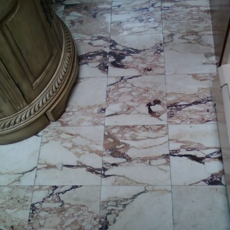 Tranished Small Bathroom. Unpolished Marble Floor