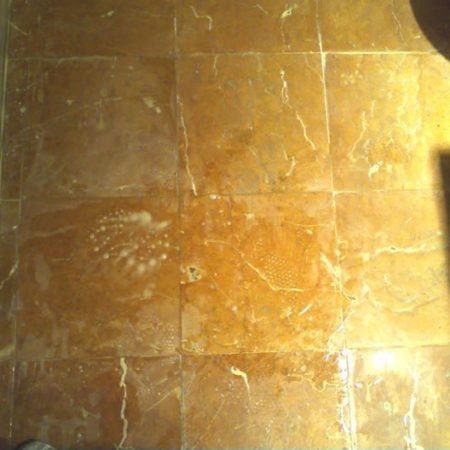 Tarnished Bathroom Floor During Restoration
