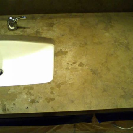 White Etches & Burns on Brown Limestone Vanity