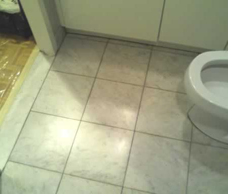 Shabby White Marble Floor in Bathroom
