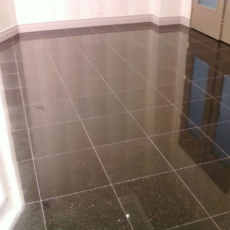 Pure Black Galaxy Granite. Wax Stripping