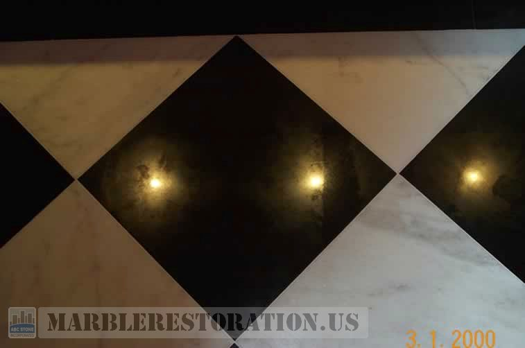 Cloudy Spots On Black Granite Floor Tiles Caused By