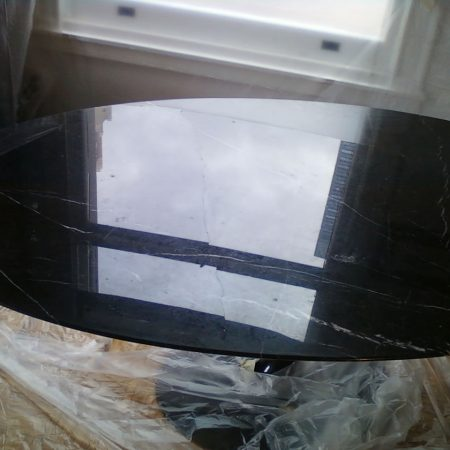 Buckling Black Oval Table with Internal Crack