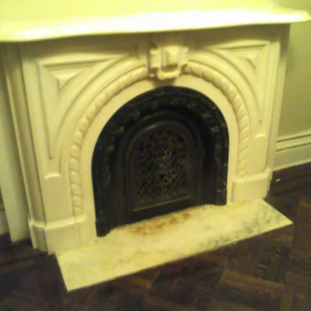 Ornamental White Marble Fireplace. After Restoration