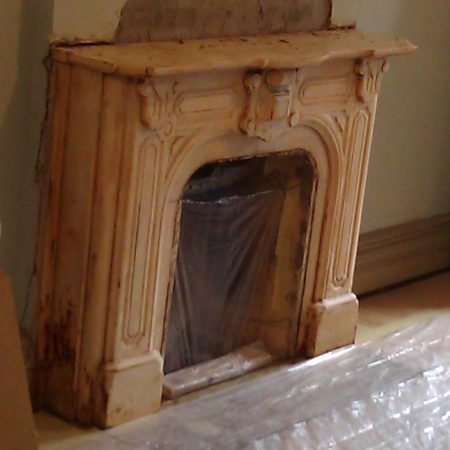 Aged Marble Parlor Fireplace in Brooklyn