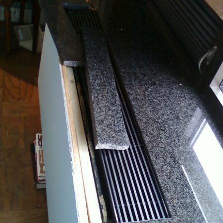 Buckling Radiator Granite Sill. Broken Off Parts