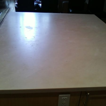 Splotchy Crema Marfil Countertop with Water Rings and Spots
