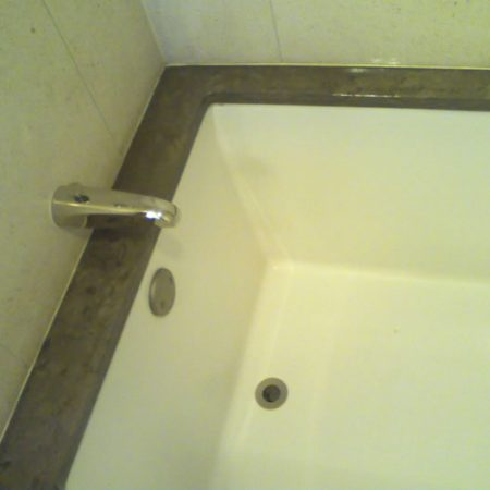 Limestone Bathtub Top. Discoloration & Erosion Removal
