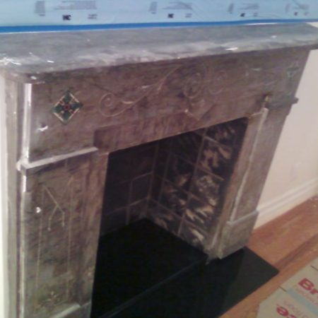 Gray Marble Fireplace in Post Construction Dirt