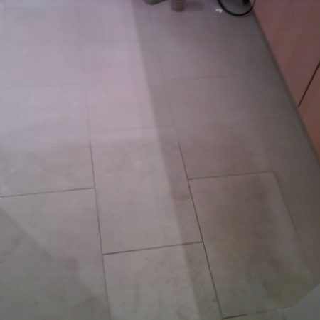 Grime Kitchen Floor. Cleaned and Not Cleaned Parts