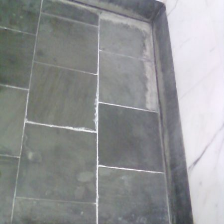 Minerals BuildUps on Shower Floor
