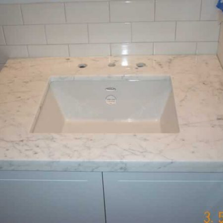 White Carrara Vanity. Sink Installed