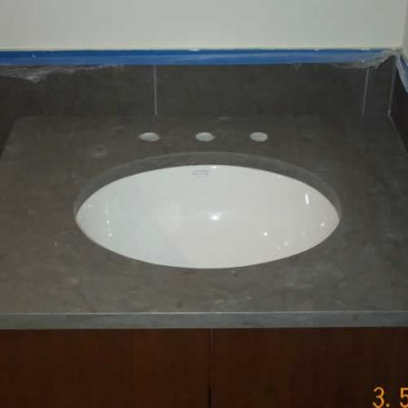 Oval Sink Installed on Limestone Vanity
