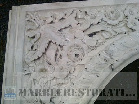 Old Paint on Carved Flowers. Fireplace