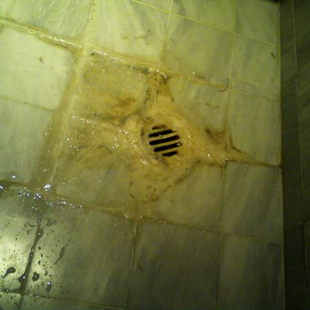 Corroded Shower Floor Build Up
