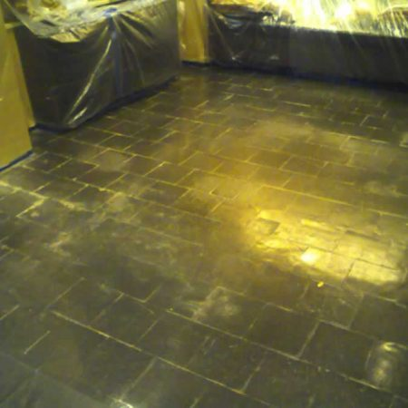 Wax Flaking off on Slatestone Floor before Grinding & Polishing