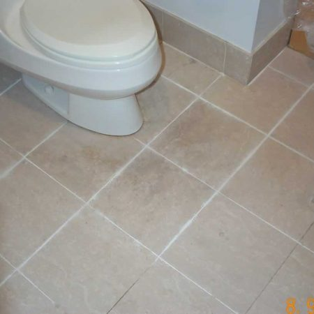 Soiled Floor in Bathroom Old Grout Removed