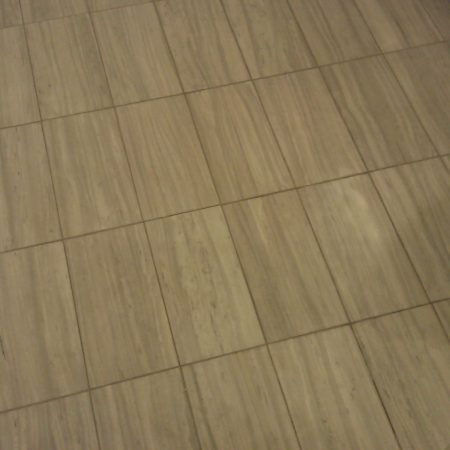 Rectangular Tiles on Bathroom Floor before Restoration