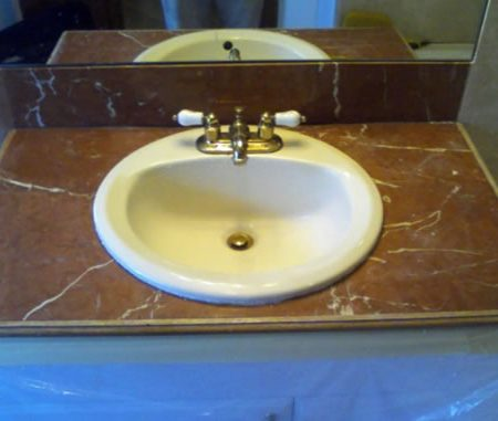 Image of Tiled Vanity Before the Repair. Rojo Alicante