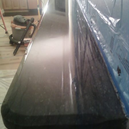 Beveled Top Slab on Fireplace. After Polishing and Sealing