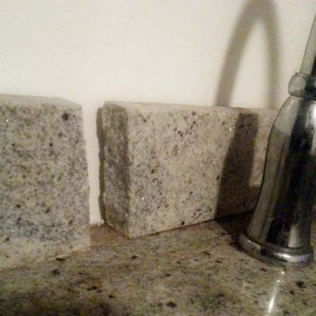 Beige Granite Backsplash Split Into Two