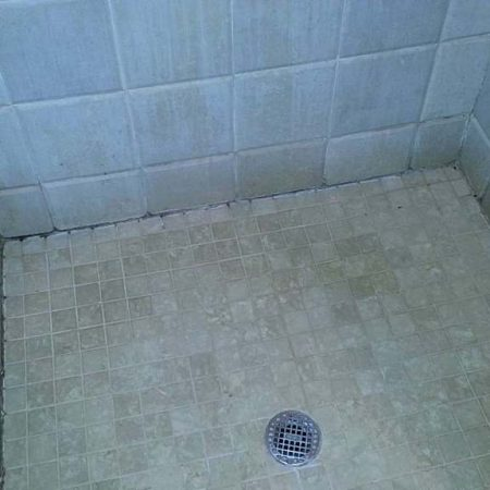 Travertine Beveled Tiles in Shower before Cleaning