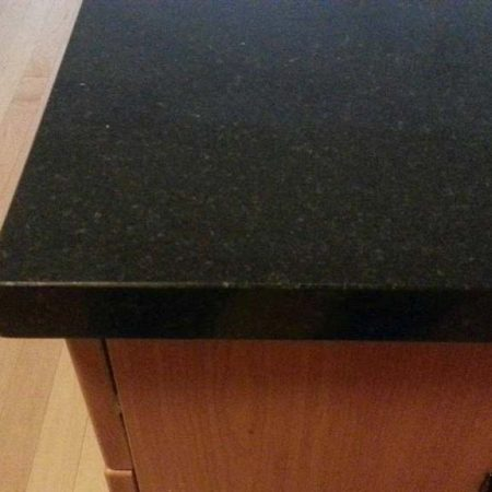 Black Granite with Gray Crystals. Chip after Repair