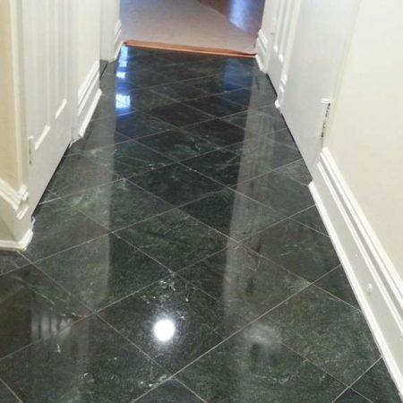 Buffed Serpentine Black Tiled Corridor