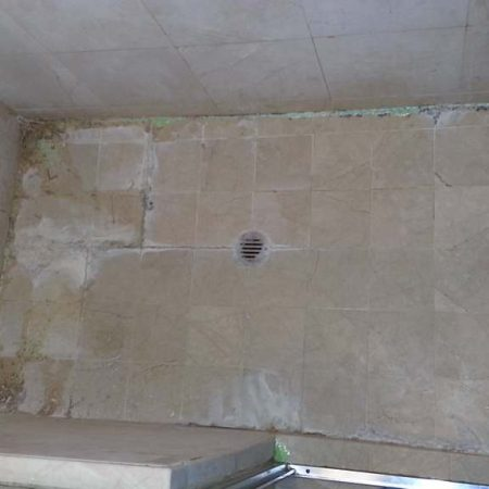 Shower Deterioration and Deep Erosion on Shower Floor