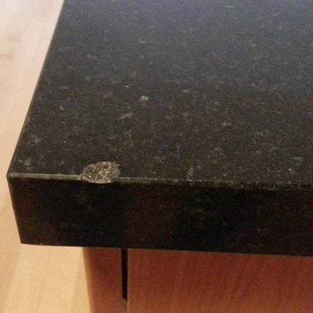 Chip on Black Granite With Gray Crystals