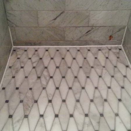 Marble Shower Floor with White Caulk on Perimeter