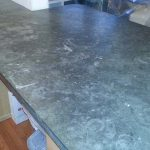 Severely Spotted Etched Burned Limestone Countertop