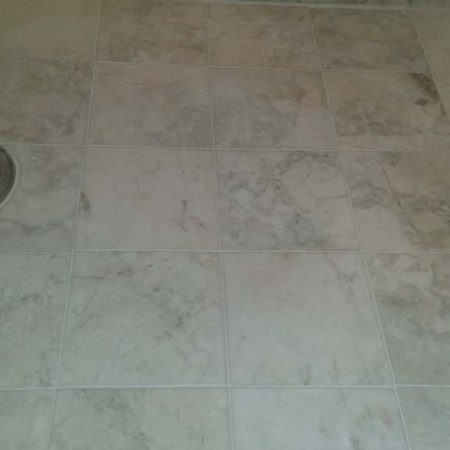 Grout Buildup Removed and Regrouted