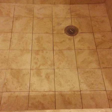 Old Grout Cut Out on Shower Stall Floor