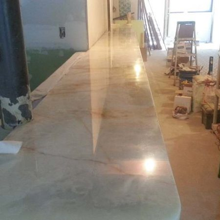 Splitted Onyx Bar Top in Restaurant. After Cracks Seaming