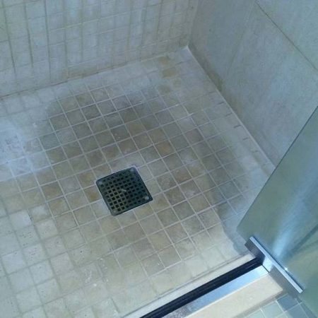 Stained Limestone Shower Floor