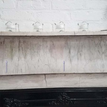 White Mantelpiece Oily Stain Left by Adhesive