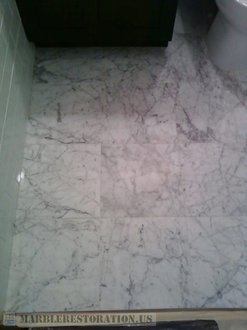 Carrara Bathroom Floor. Before Restoration