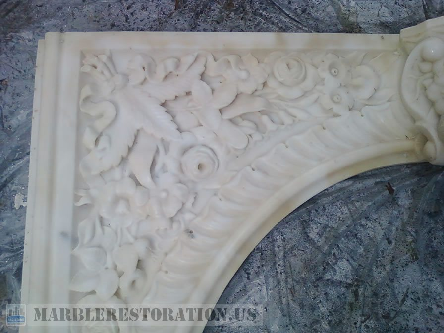 Carved Flowers in Fireplace Panel