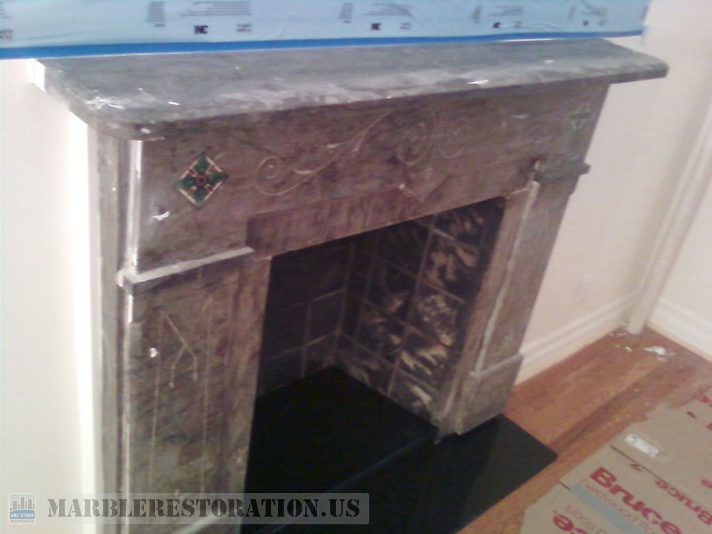 Dark Marble Fireplace Restoration