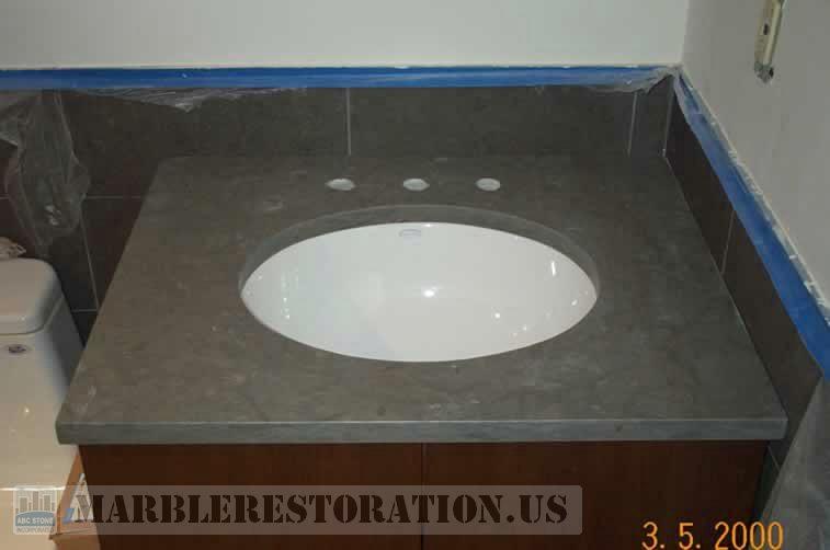 Oval Sink Installed on Limestone Vanity