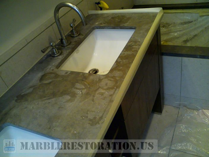 Splotchy Etches and Dull Spots on Brown Limestone Vanity