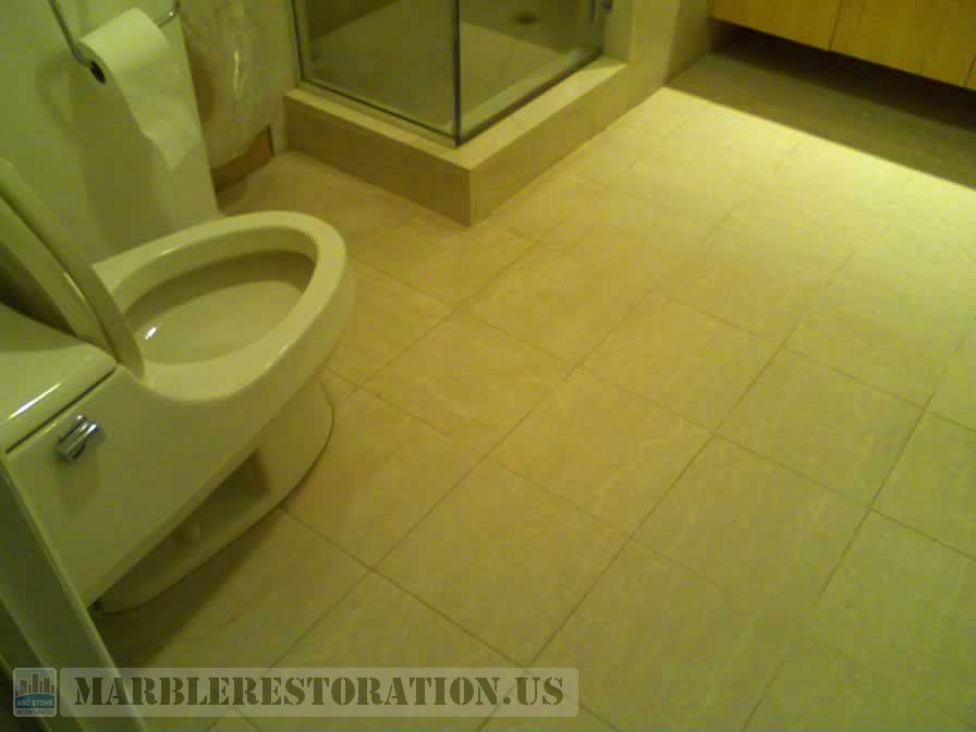 Dirty grout on bathroom floor. Before re-grouting