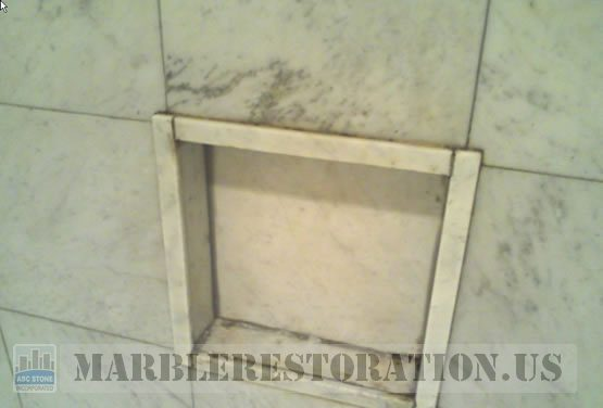 Built-in Shower Shelf. Yellowing