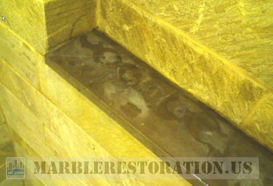 Splotchy Erosion on Shower Limestone Shelf