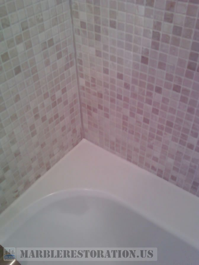 Two colors recaulking on acrylic tub and mosaic wall