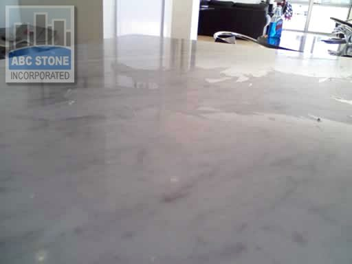 Wax Finish Flaked off on Marble Countertop