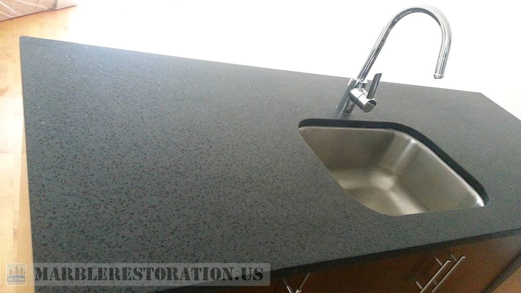 Rehoned Gray Granite Black Flakes on Kitchen Counter
