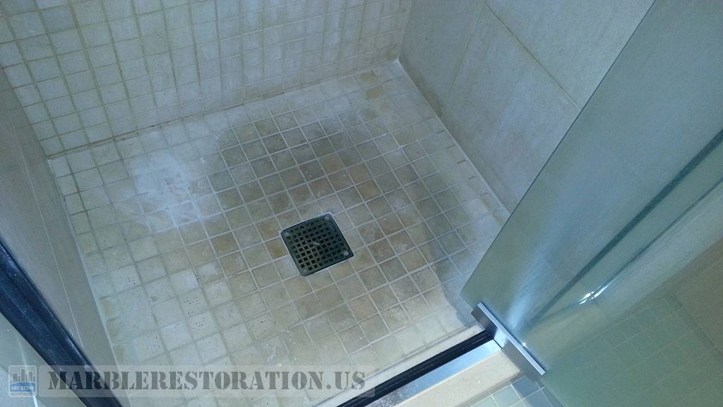Stained Limestone Shower Mosaic Floor